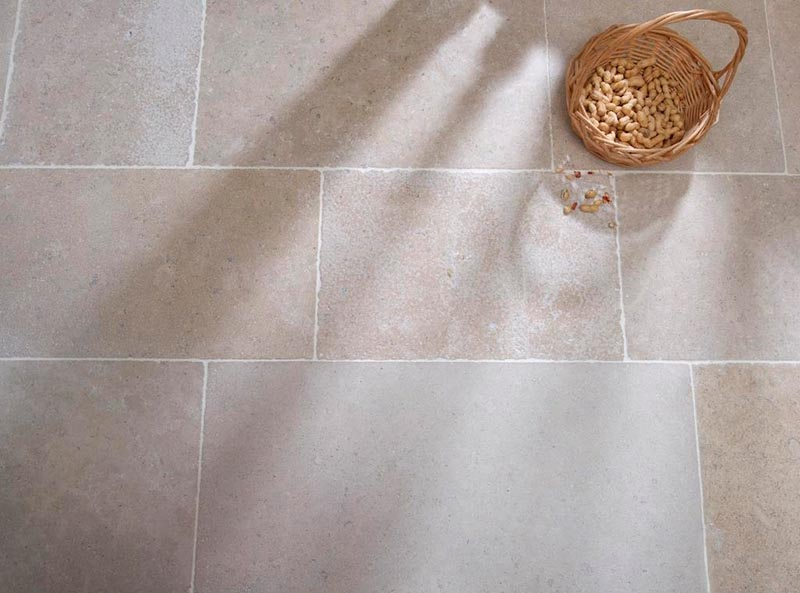 Soft coloured and textured natural stone flooring