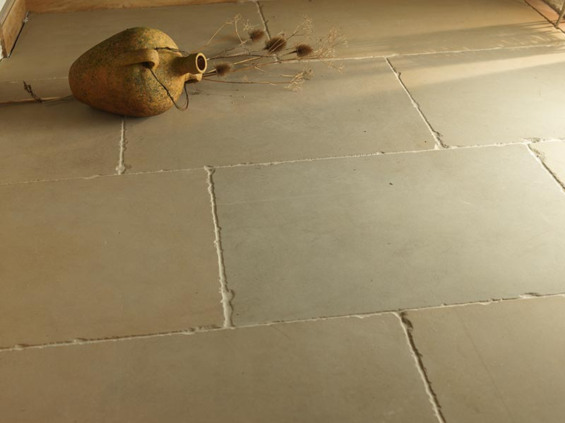 Smooth worn warm flagstone floor